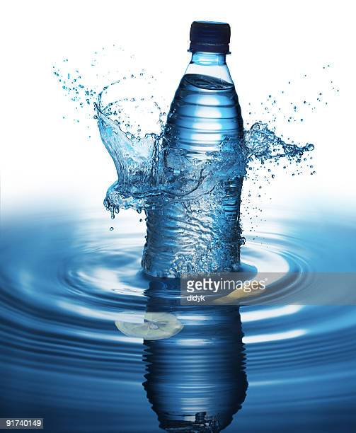 Water bottle splashing into a pool of water