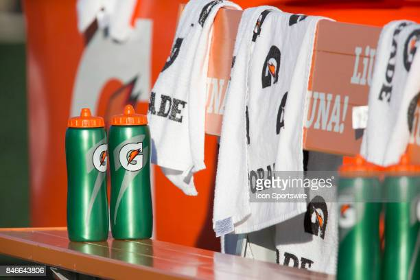 Water bottles and towels branded with Gatorade on the Hamilton TigerCats bench before a Canadian Football League game against the Ottawa Redblacks at...