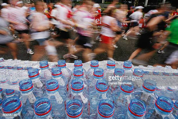Water bottles are pictured as competitors run past during the 2008 Flora London Marathon on April 13 2008 in London England
