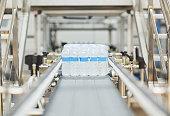 Water bottles on conveyor belt in factory