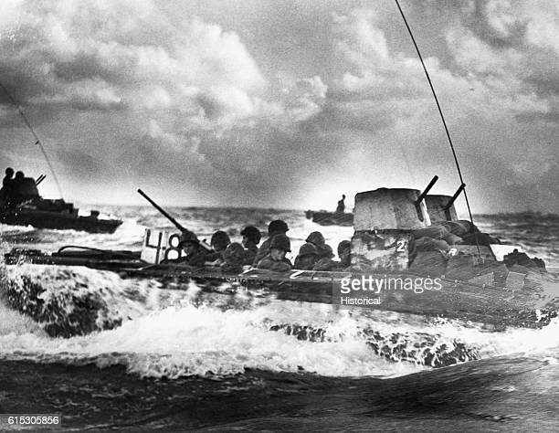 A Water Buffalo vessel loaded with Marines and bound for Tinian Island makes its way through a churning sea in July 1944 | Location near Guam