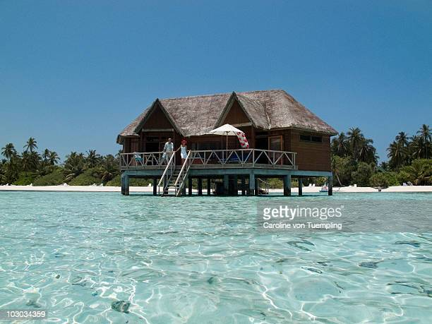 Water bungalow with couple on terrace