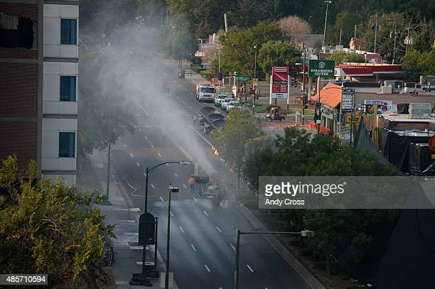 Water canons spray mist along Colorado Blvd to try and help keep down the dust for the Implosion of the University of Colorado Biomedical Research...