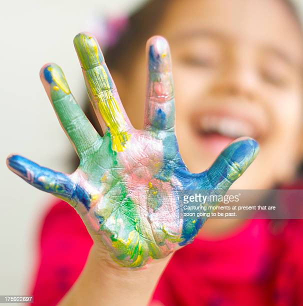 Water Colored hand of a little girl