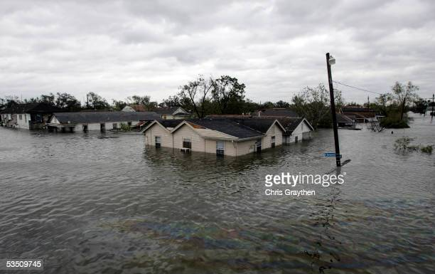 Water comes up to the roof of homes after Hurricane Katrina came through the area with high winds and water on August 29 2005 in New Orleans...