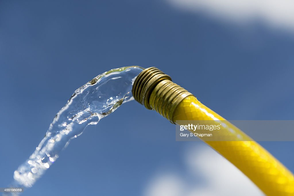 Water Coming Out Of Yellow Hose Stock Photo | Getty Images