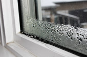 Water condensation on windows during winter.