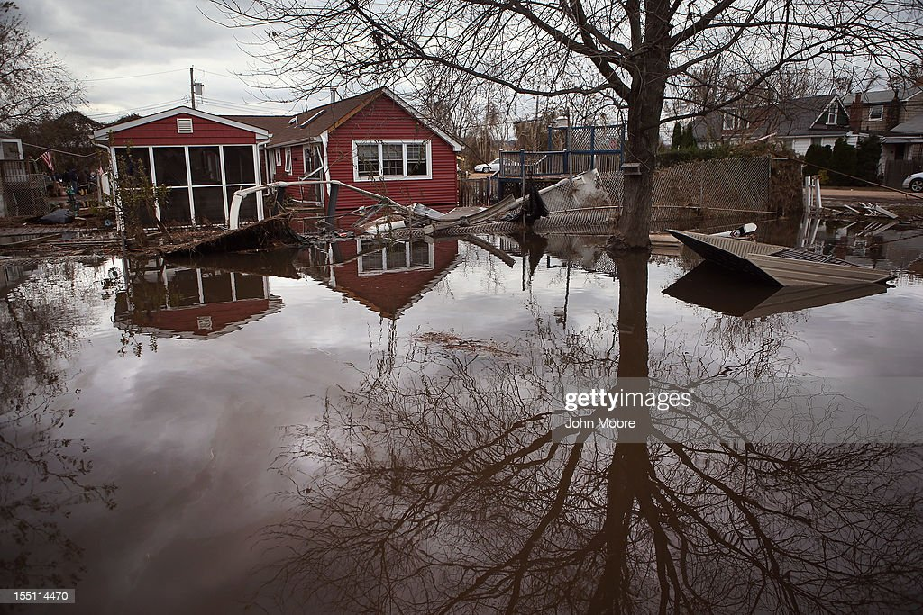 Water continues to flood a neighborhood on November 1, 2012 in the Ocean Breeze area of the Staten Island borough of New York City. Most homes in the seaside community were inundated by the ocean surge caused by Superstorm Sandy.