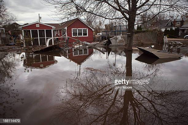 Water continues to flood a neighborhood on November 1 2012 in the Ocean Breeze area of the Staten Island borough of New York City Most homes in the...