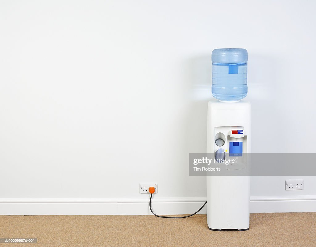 Water Cooler Plugged Into Wall In Office Closeup Stock Photo ...