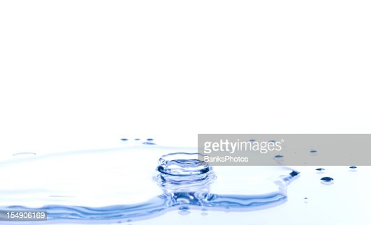 Water Crown Splash on a Reflective Surface