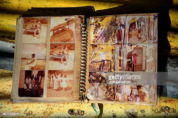 A water damaged photo album dries in the sun in the village of Siviri 70 kilometres north of Vanuatu's capital Port Vila on March 21 2015 after...