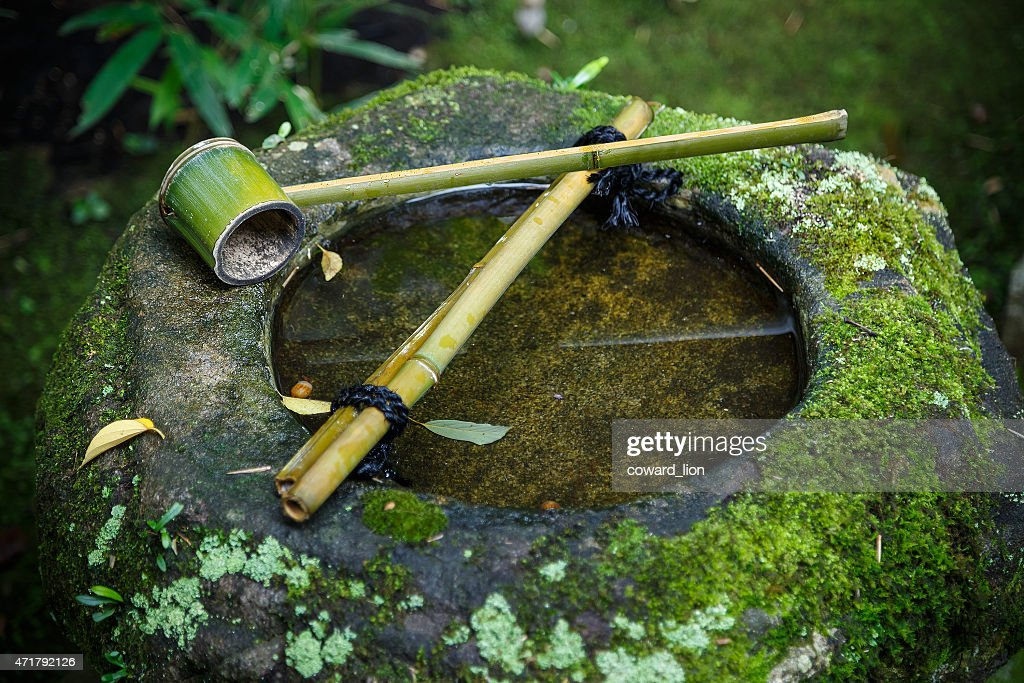 Water Dipper On A Stone Basin In A Japanese Garden : Stock Photo