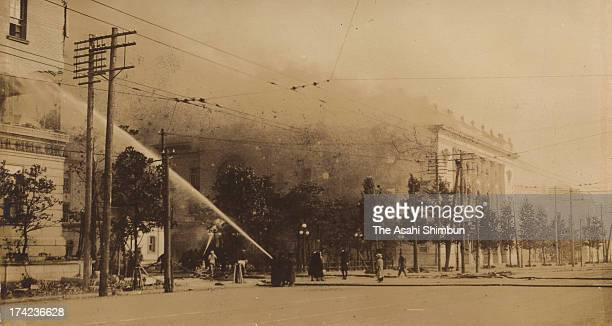 Water discharges toward Teikoku Gekijo Theatre in flame after the Great Kanto Earthquake in September 1923 in Tokyo Japan The estimated Magnitude 79...