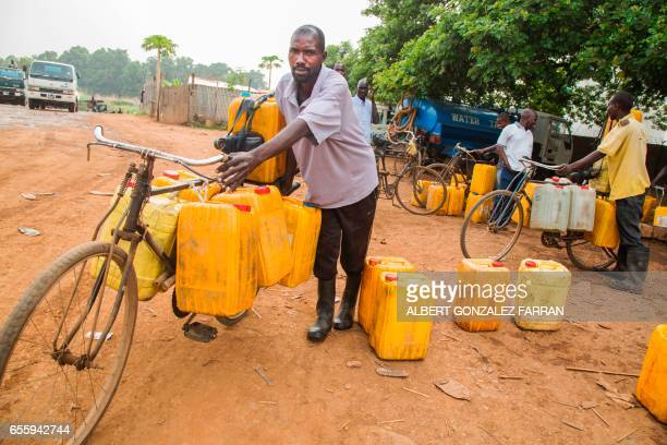 Water distributors collect water from a water point on March 21 2017in Juba South Sudan to provide treated water to residents International World...