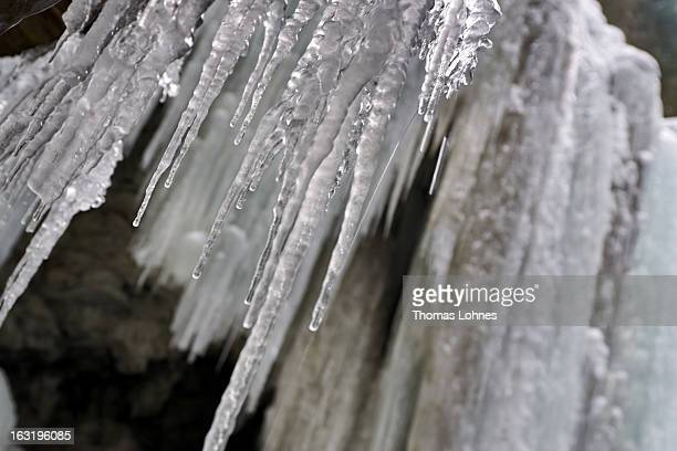Water drips from the icicles in the Breitachklamm Canyon at Tiefenbach near Oberstorf on March 5 2013 in Oberstdorf Germany The remarkable nature...
