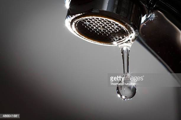 Water drop falling from a tap on April 23 in Berlin Germany Dripping water tap