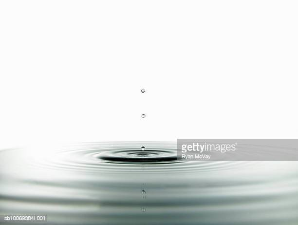 Water drop hitting surface, studio shot
