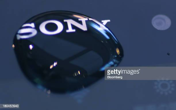 A water droplet sits on the surface of a Sony Corp Xperia Z1 smartphone at one of the company's showrooms in Tokyo Japan on Friday Sept 13 2013 Sony...