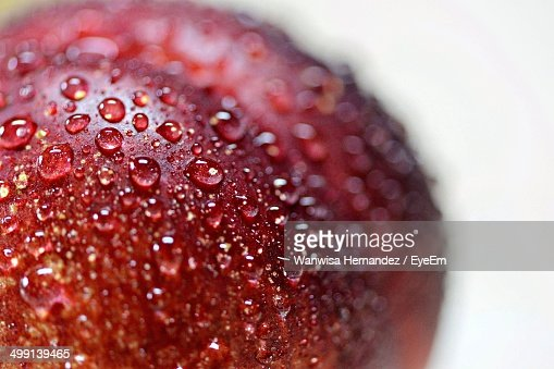 Water drops on fresh peach over white background