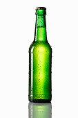 Water drops on green beer bottle