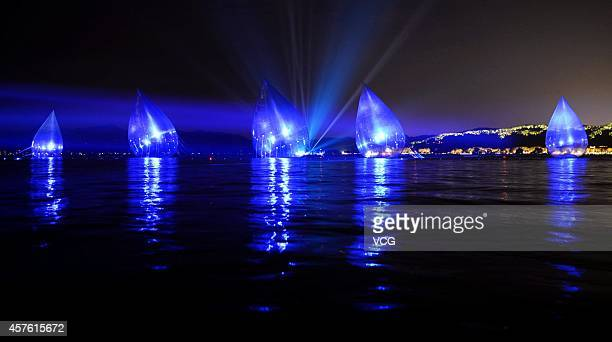 Water dropshaped airfilled models are placed on the lawn at West Lake on October 18 2014 in Hangzhou China A performing art exhibition of 'Dancing...
