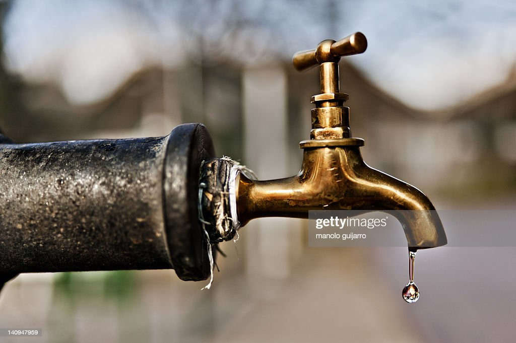 Water falling from tap : Stock Photo