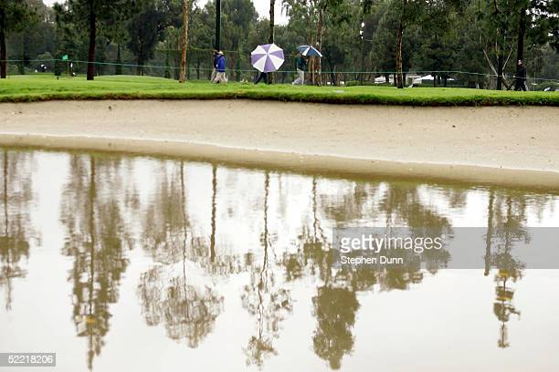Water fills a sand trap on the 18th fairway before the delayed second round of the Nissan Open on February 19 2005 at the Riveria Country Club in...