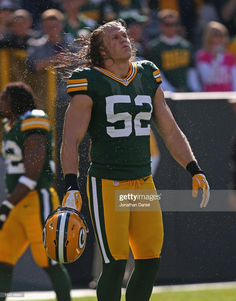 Water flies off of the head of Clay Matthews #52 of the Green Bay Packers during warm-ups before a game between the Packers and the New Orleans Saints at Lambeau Field on September 30, 2012 in Green Bay, Wisconsin.