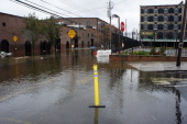 Water floods Van Brunt Street in the Red Hook neighborhood of the Brooklyn borough of New York US on Tuesday Oct 30 2012 New York City officials...