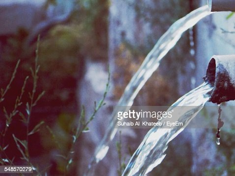 Water Flowing From Pipes Outdoors