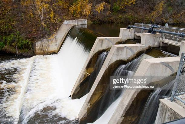 water flowing over a dam