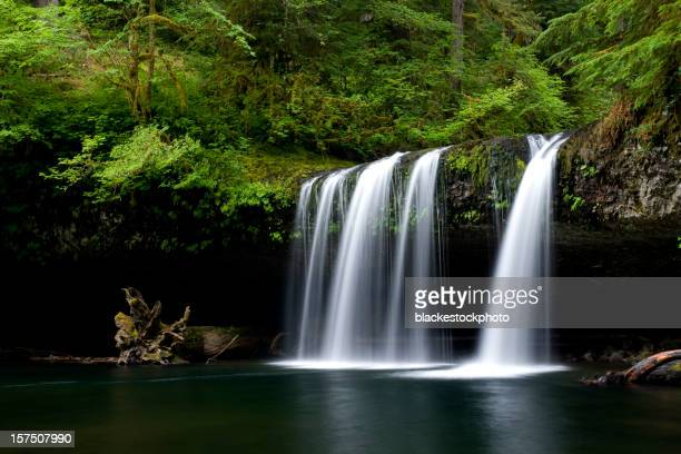 Water flowing over columnar basalt outcropping and cliff