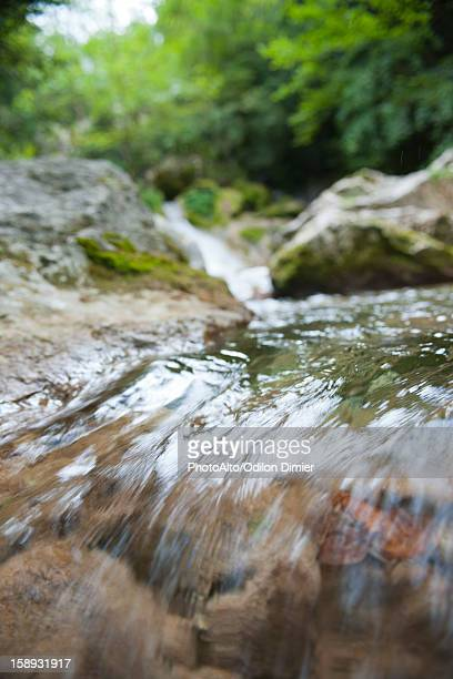 Water flowing over rocks, close-up