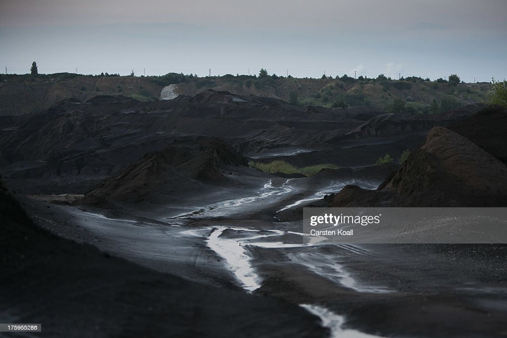 Water flows over the ground at the Welzow open-pit lignite coal mine on August 10, 2013 near Welzow, Germany. The mine, operated by Vattenfall, is one of several in the immediate area that feed a nearby power plant with coal. In a development project initiated by state government, other nearby former open-pit mines have been turned into lakes in a rejuvenation effort that is also intended to make the area a viable tourist destination.