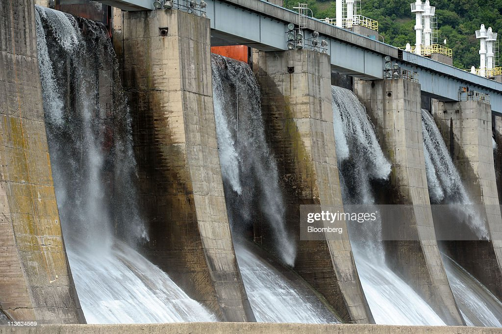 Water flows through the spillways at the Djerdap 1 dam, Serbia's largest hydro-electric power plant which is operated by Elektroprivreda Srbije, on the Danube river in Kladovo, Serbia, on Wednesday, May 4, 2011. Serbia expects as much as 9 billion euros ($13.4 billion) to be invested in the overhaul and development of its energy sector by 2015, according to Dusan Mrakic, a state secretary with the Energy and Mining Ministry. Photographer: Oliver Bunic/Bloomberg via Getty Images