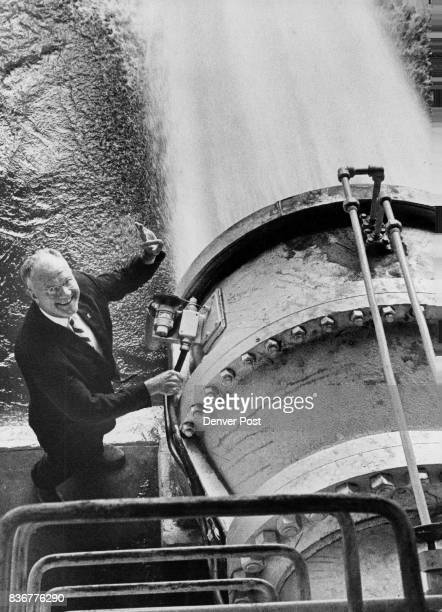 Water From Dillon Reservoir Pours From East End Of Roberts Tunnel Robert Millar secretarymanager of the Denver Water Board gives the OK sign Credit...