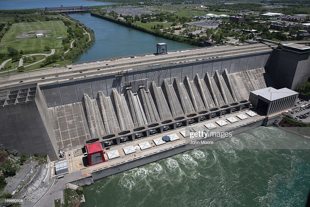 Water from the Niagara River passes through a hydroelectric dam the Robert Moses Generating Facility on June 4, 2013 at Lewiston, New York. When the power plant went online in 1961 it was the biggest hydroelectric producer in the Western world and is still the main source of electricity for the State of New York. The aerial view was seen from a helicopter flown by the U.S. Office of Air and Marine, (OAM), which monitors and patrols the U.S. northern border with Canana.