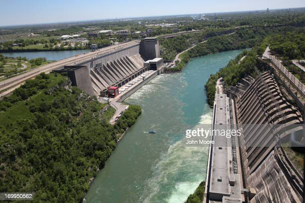 Water from the Niagara River passes through a hydroelectric dam the Robert Moses Generating Facility on June 4 2013 at Lewiston New York When the...