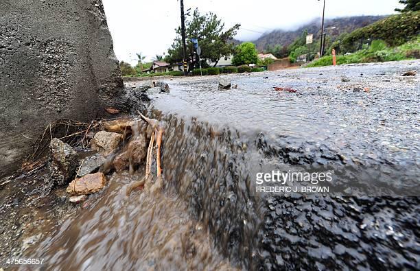 Water from the rain slides off the road in a hillside neighborhood of Glendora California on February 28 2014 Heavy rain hit southern California...