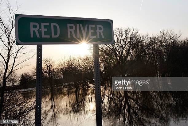 Water from the Red River overflows the banks as North Dakota prepares for a potential flood on as North Dakota prepares for a potential flood on...