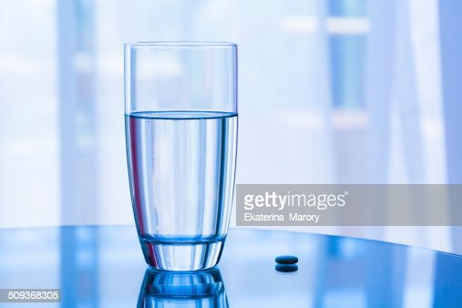 water  glass and pill : Stock Photo
