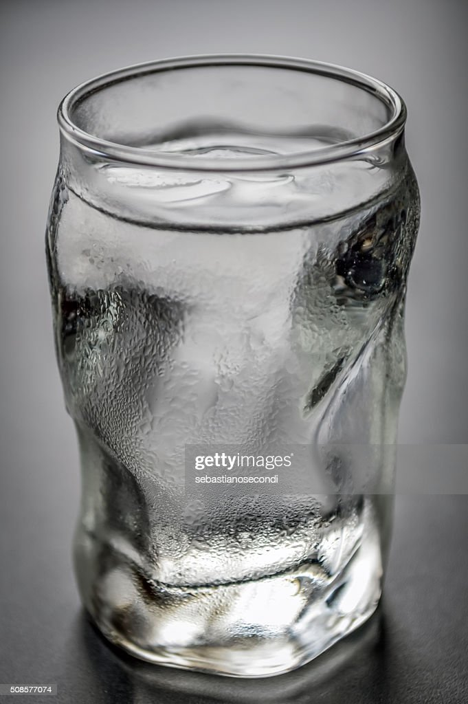 water glass with ice and condensation : Stockfoto