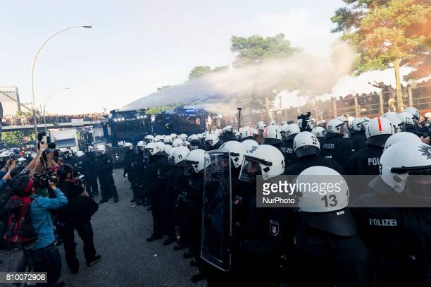 A water gun sprays towards the demonstrators in Hamburg Germany on July 6 2017 The police stopped the leftradical demonstration quotG20 Welcome to...