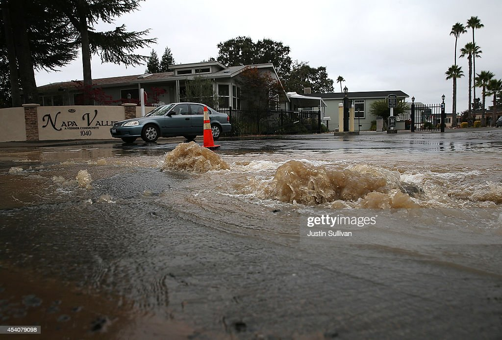Water gushes from the ground from a water main break oustide of a mobile home park following a reported 6.0 earthquake on August 24, 2014 in Napa, California. A 6.0 earthquake rocked the San Francisco Bay Area shortly after 3:00 am on Sunday morning causing damage to buildings and sending at least 70 people to a hospital with non-life threatening injuries.