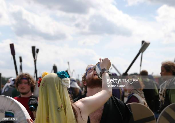 A water herald from the Cult of Hydration pours water into the mouth of a fighter at Ragnarok XXXII on June 21 2017 For one week each summer the...