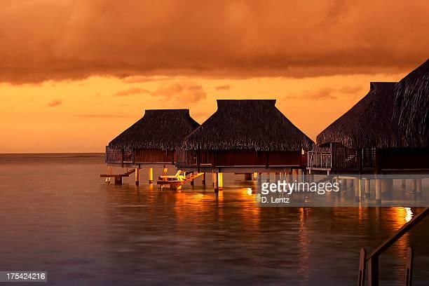 Water houses in the Tahiti Sunset
