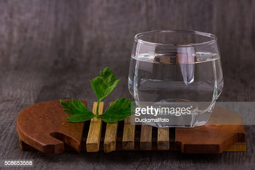 water in glass old wood background : Stock Photo