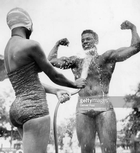 Water in the face doesn't seem to bother brawny Cpl William Sanders of Lowry air force base particularly since shapely Mary Hewing of 2918 Marion St...