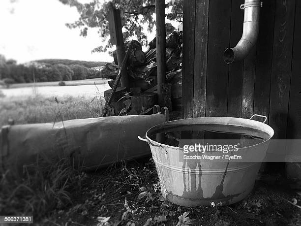Water In Tub On Landscape Against Clear Sky